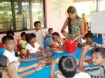 The children having a meal of porridge/gruel